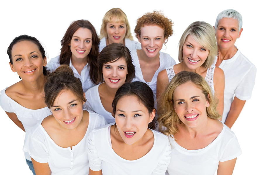 Cheerful female models smiling at camera on white background